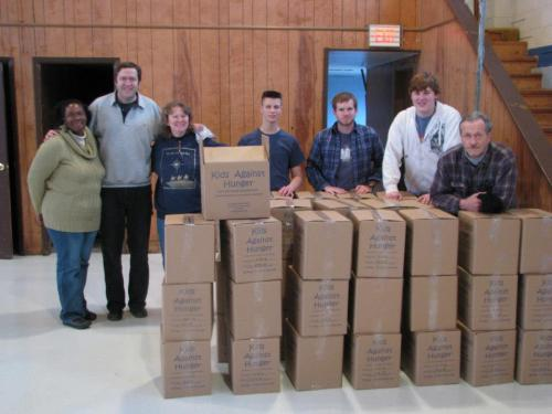 Rozetta Baptist Church and Kids Against Hunger donate food to Rev. Scott Reese & Christ Cares